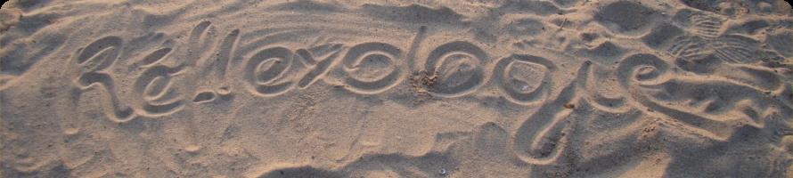 Fond de sable avec le mot Réflexologie